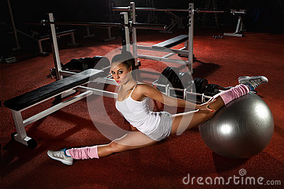 Woman exercising Pilates ball