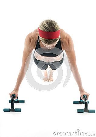 Woman exercising  push up  fitness  bar
