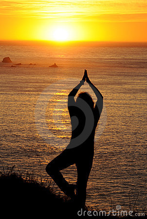 Woman exercising at sunset on the West coast