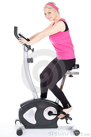 Woman exercising on training bicycle