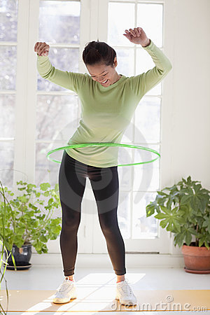 Free Woman Exercising With Hula Hoop Royalty Free Stock Photo - 10283555