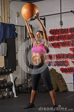 Free Woman Exercising With Medicine Ball Royalty Free Stock Photos - 51975548