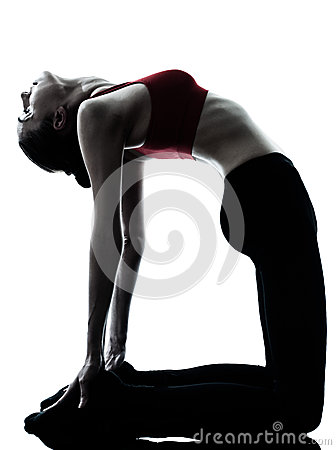 Woman exercising yoga camel pose