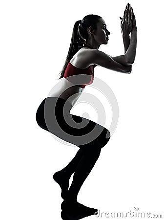 Woman exercising yoga eagle pose