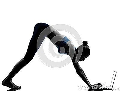 Woman exercising yoga using computer laptop