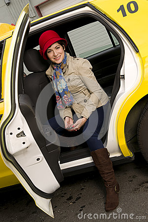 Attractive Woman Traveler exits a Taxi Cab