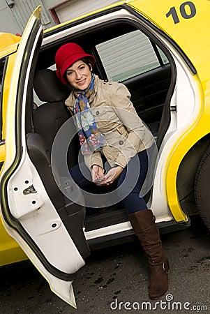 Attractive Woman Traveler exits a Taxi Cab