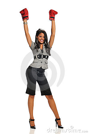 Woman expressing victory wearing boxing gloves