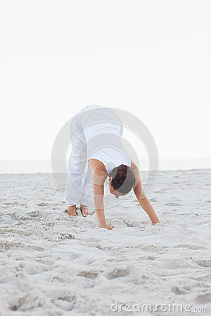 Woman in extended triangle yoga pose