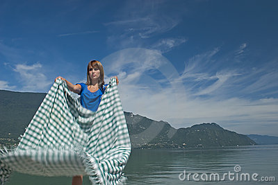Woman extending a tablecloth