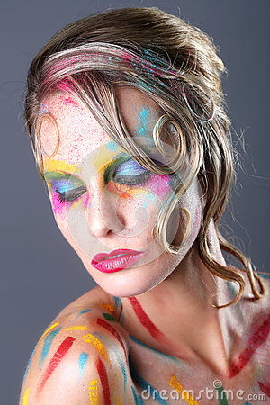 Woman With Extreme Makeup Design With Colorful Powder