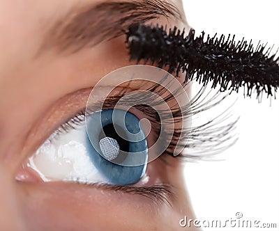Woman eye with mascara brush