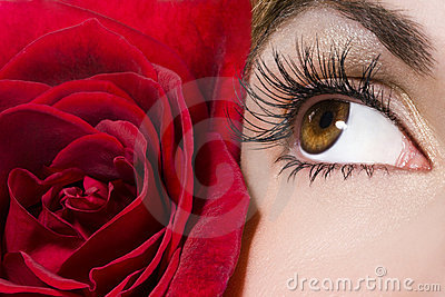 Woman eye and red rose