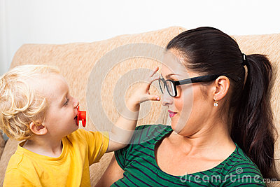 Woman in eyeglasses and child