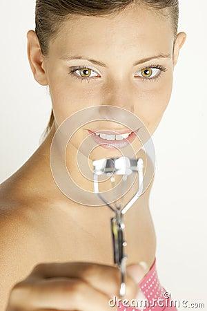 Woman with eyelash tweezers