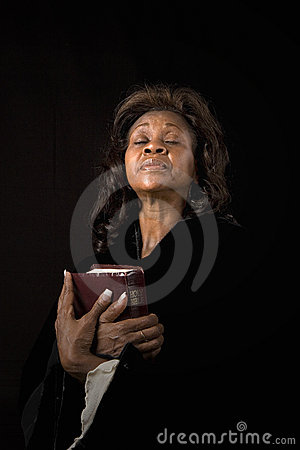 Woman Eyes Closed With Bible Royalty Free Stock Photo - Image: 4450845