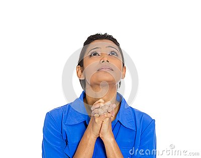 Woman eyes closed praying hoping for the best