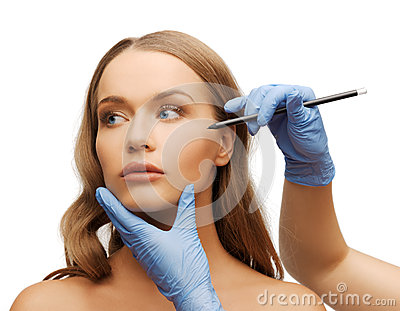Woman face and beautician hands with pencil