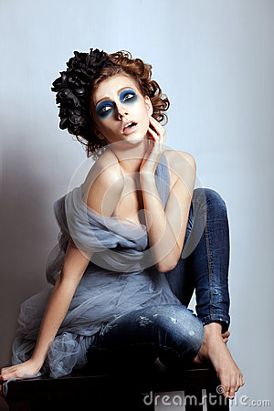 Woman face bright blue makeup. Fantasy, glamour