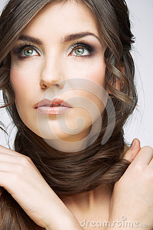 Woman face close up beauty portrait. Girl with lon