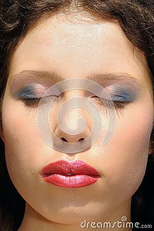 Woman face closeup, makeup
