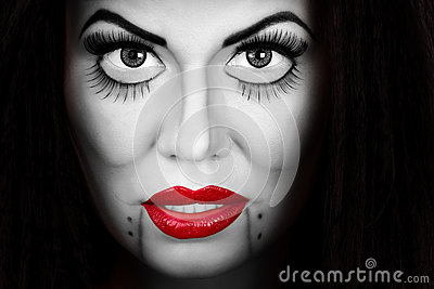 Woman face with creative make up and eyelashes