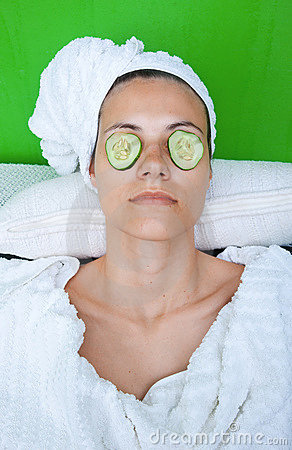 Woman face with cucumber mask