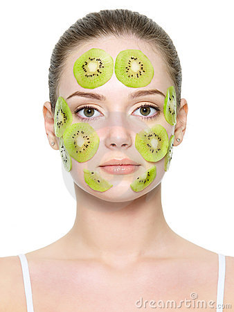 Woman face with fruit facial mask