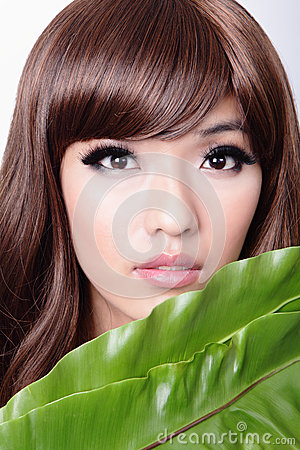 Woman face and green leaf