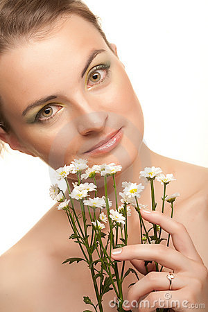 Woman face with white flowers