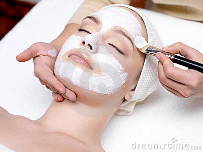Woman with facial mask at beauty salon