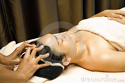 Woman in facial massage treatment