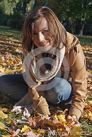 Woman with fall vibrant leaves