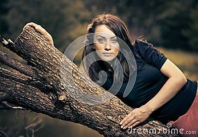 Woman on a fallen tree