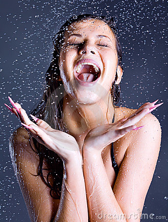 Woman with falling water droplets