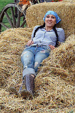 Woman Farmer Resting in Hay
