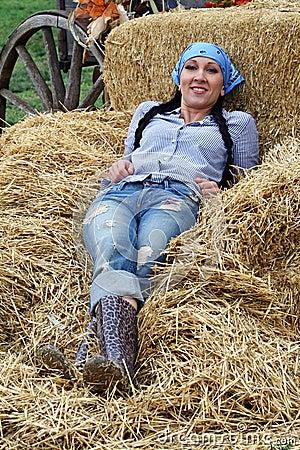 Woman Farmer Resting in Hay