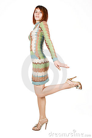 Woman in fashion dress standing on one leg