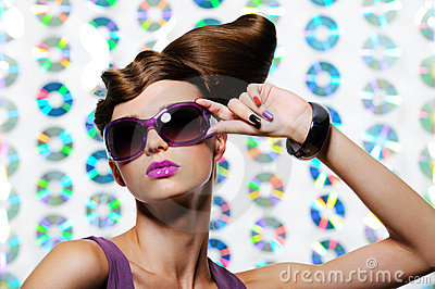 Woman in the fashion sunglasses with hairstyle