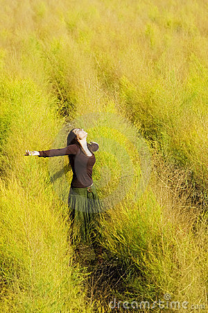 Woman feeling freedom in a field.