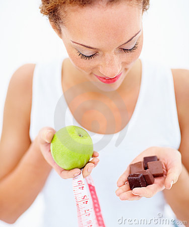 Woman feeling the temptation of eating chocolate