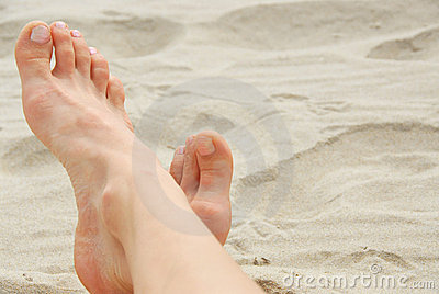 Woman feet beach