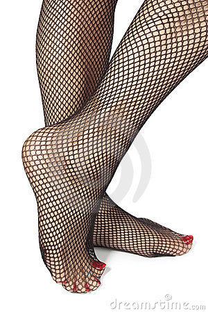 Woman feet with fishnet tights  over white
