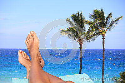 Woman feet overlooking a tropical ocean