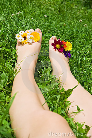 Woman feet relaxing on the grass
