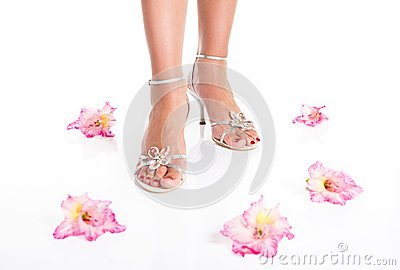 Woman feet in sandals and flowers