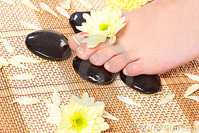 Woman feet taking over spa treatment