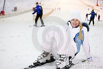 Woman fells on ski in indoor ski