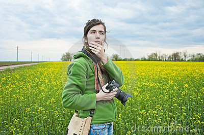 Woman in field with camera
