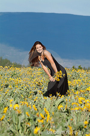 woman in field of flowers stock photo image 1938760
